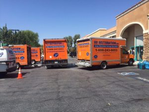 911 Restoration Vehicles At A Commercial Job Site